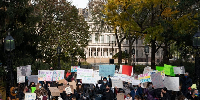 Parents and children gather in front of New York's City Hall to protest the closing of public schools, Thursday, Nov. 19, 2020.<br>  (AP Photo/Mark Lennihan)