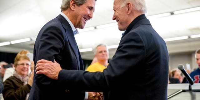 FILE - In this Feb. 1, 2020, file photo Democratic presidential candidate former Vice President Joe Biden smiles as former Secretary of State John Kerry, left, takes the podium to speak at a campaign stop at the South Slope Community Center in North Liberty, Iowa. (AP Photo/Andrew Harnik, File)