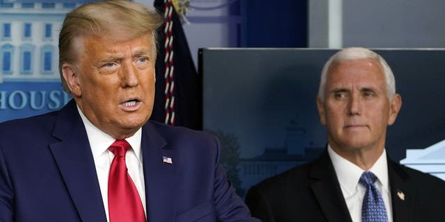 President Trump speaks in the press briefing room as Vice President Mike Pence listens Tuesday, Nov. 24, 2020, in Washington. (AP Photo/Susan Walsh)