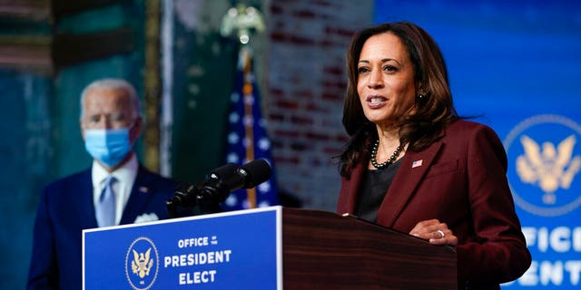 President-elect Joe Biden listens as Vice President-elect Kamala Harris speaks as they introduce their nominees and appointees to key national security and foreign policy posts at The Queen theater, Nov. 24, in Wilmington, Del. (AP Photo/Carolyn Kaster)