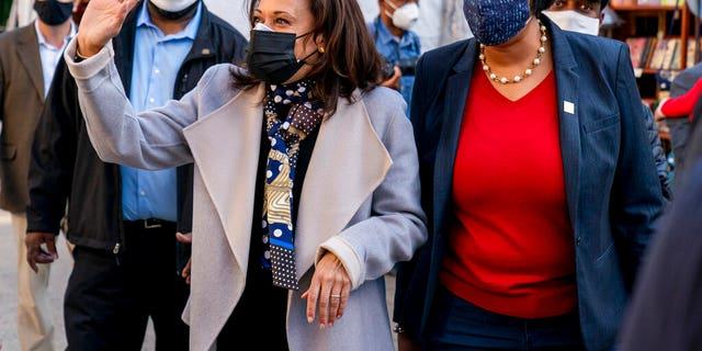 Vice President-elect Kamala Harris, center left, accompanied by Washington Mayor Muriel Bowser, right, waves while visiting the Downtown Holiday Market, Saturday, Nov. 28, 2020, in Washington.