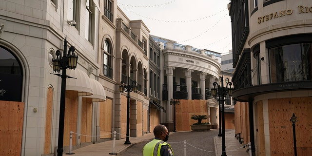 Luxury shops on Rodeo Drive are boarded up in anticipation of possible violent protests on Election Day  Nov. 3, in Beverly Hills, Calif. (AP Photo/Jae C. Hong)
