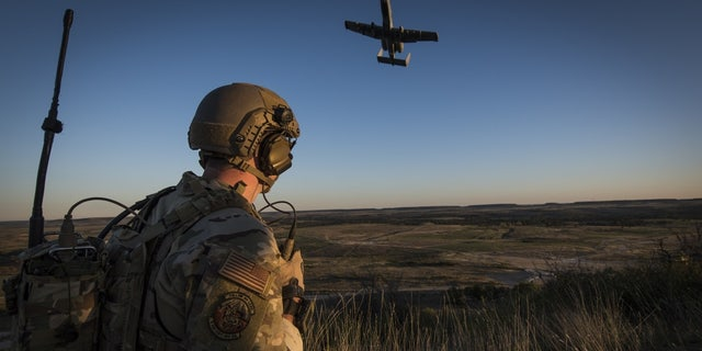 A Tactical Control Party Airman and qualified Joint Terminal Aircraft Controller assigned to the 9th Air Support Operations Squadron at Fort Hood, Texas, directs an A-10 Thunderbolt II aircraft during a close-air-support exercise at Fort Hood, Texas Oct. 30, 2020. The 330th Recruiting Squadron used this exercise, along with the 2020 Lightning Challenge to publicize the capabilities of Special Warfare Airmen.
