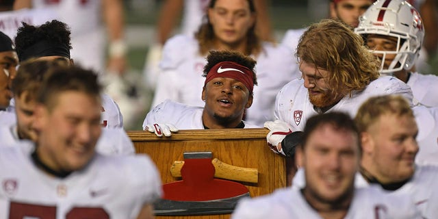 Stanford's Malik Antoine carries the Stanford Axe after Stanford defeated California 24-23 in an NCAA college football game Friday, Nov. 27, 2020, in Berkeley, Calif. (Jose Carlos Fajardo/Bay Area News Group via AP)