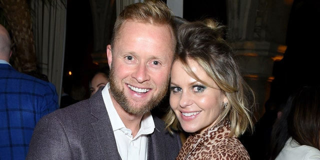 Valeri Bure and Candace Cameron-Bure and their three kids received backlash for a family photo shared to Instagram.