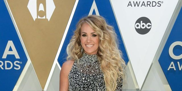 Carrie Underwood hits 2020 CMA Awards red carpet in sparkling dress