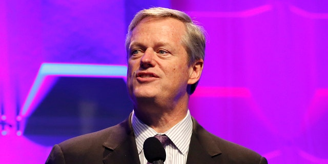 Massachusetts Gov. Charlie Baker speaks on stage during the 2018 Massachusetts Conference For Women at Boston Convention & Exhibition Center in Boston. Baker announced a series of orders Monday to curb the spread of the coronavirus that includes a stay-at-home advisory and a curfew for most businesses. (Photo by Marla Aufmuth/WireImage )