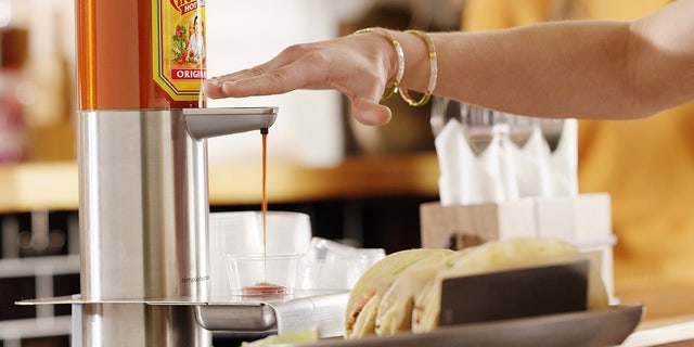 "Cholula claims to have developed ""the world's first hands-free hot sauce dispenser."""