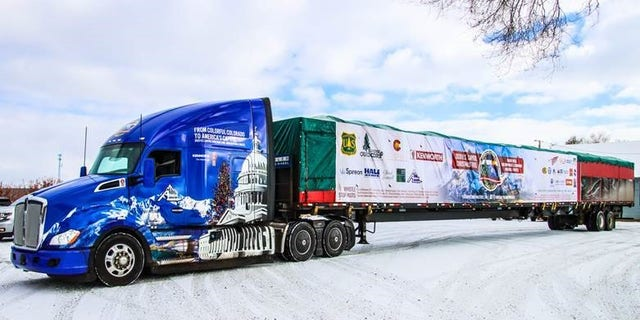 The truck with U.S. Capitol Christmas Tree in tow pictured while parked in Norwood, Colorado on November 10. Photo credit: James Edward Mills