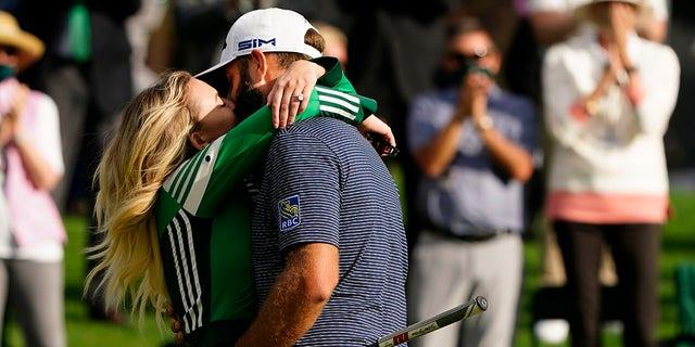 Dustin Johnson is hugged by his wife Pauline Gretzky after winning the Masters golf tournament Sunday, Nov. 15, 2020, in Augusta, Ga. (AP Photo/Matt Slocum)