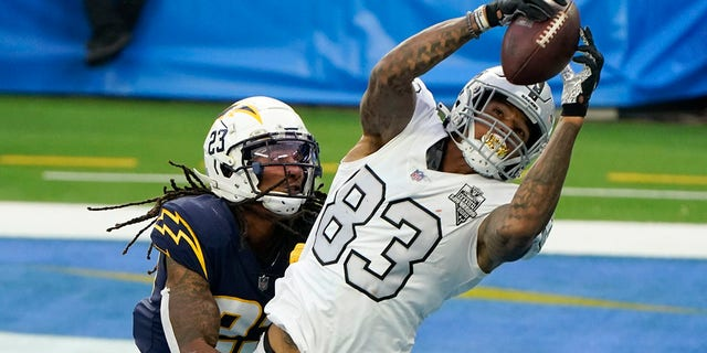 The Las Vegas Raiders tightly ended Darren Waller (83) in a touch to the ground as Los Angeles Chargers vigorously secure Rayshawn Jenkins defended the second half of an NFL football match on Sunday, November 8, 2020, in Inglewood, California (Photo AP / Alex Gallardo)