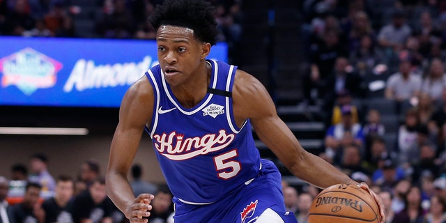 In this Feb. 20, 2020, file photo, Sacramento Kings guard De'Aaron Fox drives during the team's NBA basketball game against the Memphis Grizzlies in Sacramento, Calif. Fox agreed to a five-year, $163 million contract with the Kings on Nov. 20. (AP Photo/Rich Pedroncelli, File)