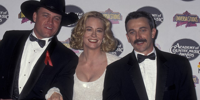 Doug Supernaw, best known for '90s hit 'Reno' died on Friday. He was 60. Photographed here from left to right is Supernaw, Cybill SHepherd and Aaron Tippin at the 30th annual Academy of Country Music Awards in Universal City, Calif.
