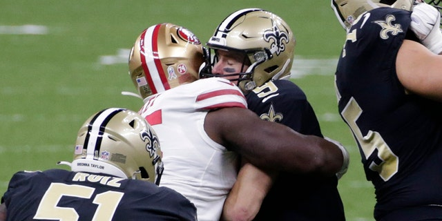 FILE - In this Nov. 15, 2020, file photo, San Francisco 49ers defensive end Kentavius Street (95) sacks quarterback Drew Brees (9) during the first half of an NFL football game in New Orleans. (AP Photo/Butch Dill, File)