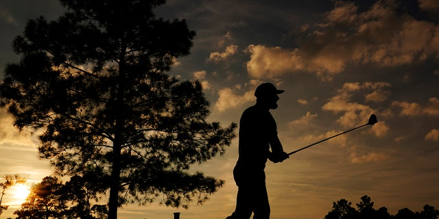 Dustin Johnson watches his shot on the 18th hole during the third round of the Masters golf tournament Nov. 14, in Augusta, Ga. (AP Photo/Matt Slocum)