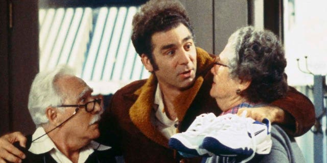 From left to right: Michael Robello as Pop, Michael Richards as Cosmo Kramer and Elsa Raven as the mother in an episode of 'Seinfeld.'  (Photo by J. Delvalle / NBCU Photo Bank / NBCUniversal via Getty Images)