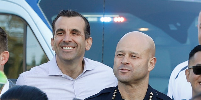 San Jose Police Department Police Chief Eddie Garcia, center right, and Mayor Sam Liccardo, center left, pose for picture. (Nhat V. Meyer/Digital First Media/The Mercury News via Getty Images)