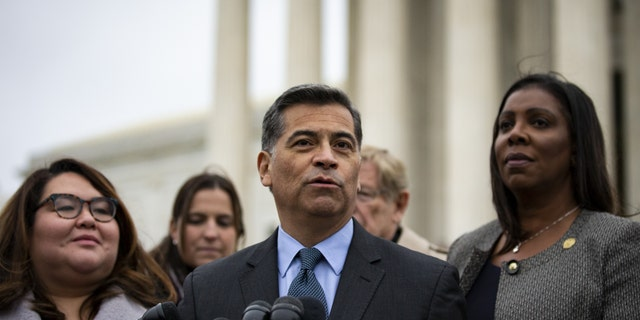 Xavier Becerra, California's attorney general, center, speaks during a news conference outside the Supreme Court in Washington, D.C., U.S., on Tuesday, Nov. 12, 2019. Photographer: Al Drago/Bloomberg via Getty Images