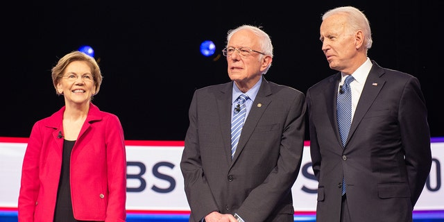 FILE - 2020 presidential candidates Senator Elizabeth Warren, a Democrat from Massachusetts, left, Senator Bernie Sanders, an Independent from Vermont, and former Vice President Joe Biden, arrive on stage ahead of the Democratic presidential debate in Charleston, South Carolina, on Feb. 25, 2020. Photographer: Alice Keeney/Bloomberg via Getty Images