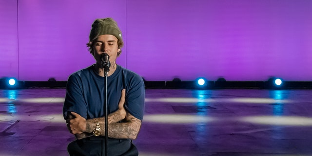 Justin Bieber performs at The 54th Annual CMA Awards, hosted by Reba McEntire and Darius Rucker. The 26-year-old pop star also recently performed his hits 'Lonely' and 'Holy' at the People's Choice Awards and American Music Awards.