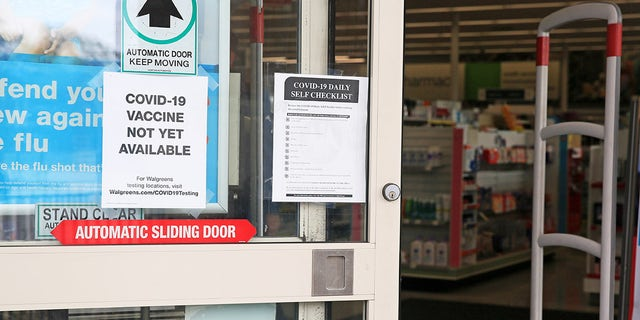 HOUSTON, Nov. 25, 2020 -- A notice telling COVID-19 vaccine is not yet available is pictured on the door of a pharmacy in New Orleans, Louisiana, the United States, (Photo by Lan Wei/Xinhua via Getty) (Xinhua/Wei Lan via Getty Images)