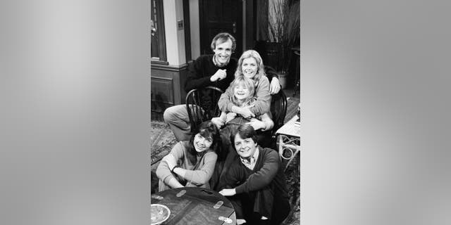 Pictured: (Front, l-r) Justine Bateman as Mallory Keaton, Michael J. Fox as Alex P. Keaton, (Back, l-r) Michael Gross as Steven Keaton, Meredith Baxter as Elyse Keaton, Tina Yothers as Jennifer Keaton in 'Family Ties.' (Photo by Paul Drinkwater/NBCU Photo Bank/NBCUniversal via Getty Images)