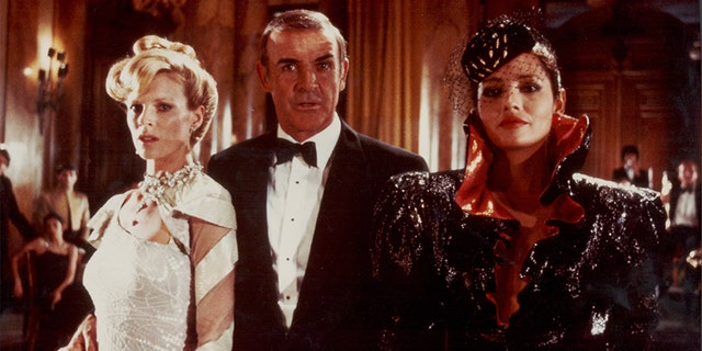 Actor Sean Connery as James Bond, with Bond girls Kim Basinger and Barbara Carrera, in a scene from the film 'Never Say Never Again,' 1983.