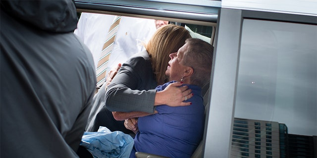 Mother Mary Lyons is pictured getting a hug after Lloyd Lee Welch Jr. was indicted on first-degree murder charges.
