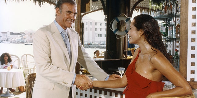 Actor Sean Connery and actress Barbara Carrera on the set of 'Never Say Never Again.'