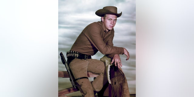 "Portrait of American actor Steve McQueen (1930-1980) (as Josh Randall) perched atop a fence in the television series ""Wanted: Dead or Alive,"" late 1950s or early 1960s."