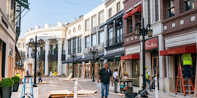 Workers were seen Monday boarding up the stores on Via Rodeo on Rodeo Drive as a precautionary measure in preparation for the 2020 Presidential Election on Tuesday, Nov. 3 in Beverly Hills, Calif. (Photo by AaronP/Bauer-Griffin/GC Images)