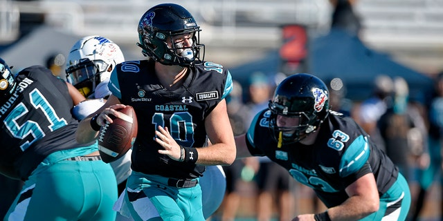 Coastal Carolina quarterback Grayson McCall (10) looks for a receiver during the first half of an NCAA college football game against Appalachian State, Nov.. 21, in Conway, S.C. (AP Photo/Richard Shiro)