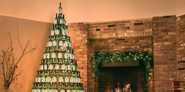 "Jameson Irish Whiskey is giving away Christmas ""trees"" made with over 100 of its whiskey bottles and a unique lighting system. (Jameson)"