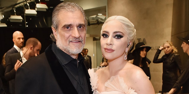 Joe Germanotta (left) said he is 'extremely proud' of his daughter, Lady Gaga (right).  (Kevin Mazur/Getty Images for NARAS)