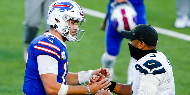 Buffalo Bills' Josh Allen, left, shakes hands with Seattle Seahawks' Russell Wilson after an NFL football game Sunday, Nov. 8, 2020, in Orchard Park, N.Y. (AP Photo/John Munson)