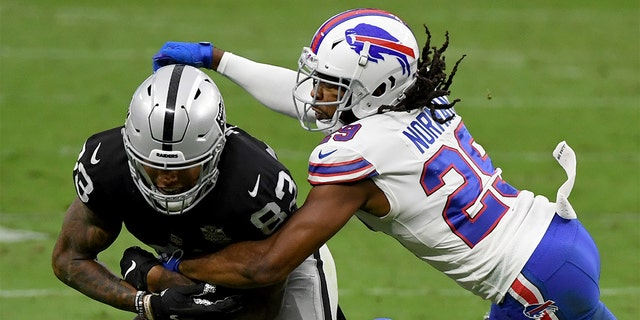 LAS VEGAS, NEVADA - OCTOBER 04: Cornerback Josh Norman #29 of the Buffalo Bills knocks the ball away from tight end Darren Waller #83 of the Las Vegas Raiders during the second half of the NFL game at Allegiant Stadium on October 4, 2020, in Las Vegas, Nevada. (Photo by Ethan Miller/Getty Images)
