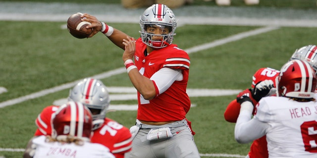 Ohio State quarterback Justin Fields throws a pass against Indiana during the first half of an NCAA college football game Saturday, Nov. 21, 2020, in Columbus, Ohio. (Associated Press)