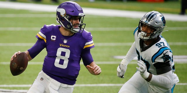 Minnesota Vikings quarterback Kirk Cousins (8) runs from Carolina Panthers defensive end Yetur Gross-Matos (97) during the first half of an NFL football game, Sunday, Nov. 29, 2020, in Minneapolis. (AP Photo/Bruce Kluckhohn)
