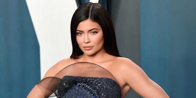 Kylie Jenner promoted her Grinch-themed makeup line with some sultry bikini snaps on Instagram. (Photo by Karwai Tang/Getty Images)
