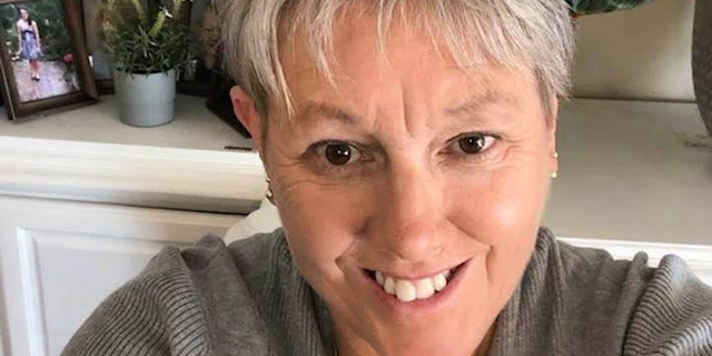Liz Pearce, a communications professor at the University of Iowa, went viral online after she offered Thanksgiving meals to any kids who can't go home for the holidays because of the coronavirus pandemic. (Liz Pearce)