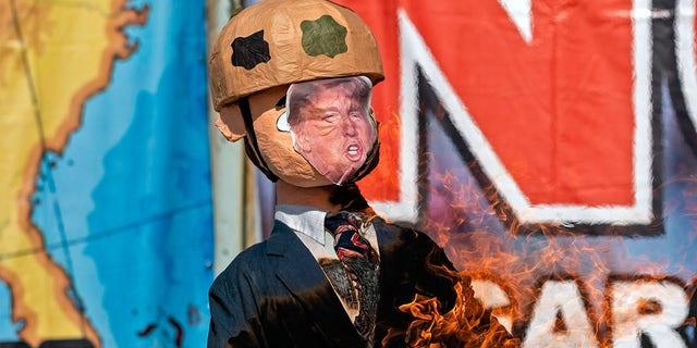 A Trump piñatais burnt during a protest against his administration's immigration policies on the U.S. border in Tijuana.