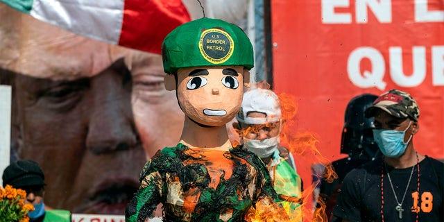 Protesters also burned a piñatadepicting a U.S. border patrol agent.