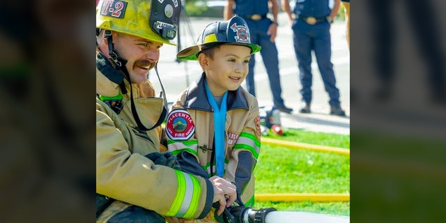 Mason Ochoa, 4, was made honorary firefighter/paramedic for saving his 2-year-old brother from drowning.