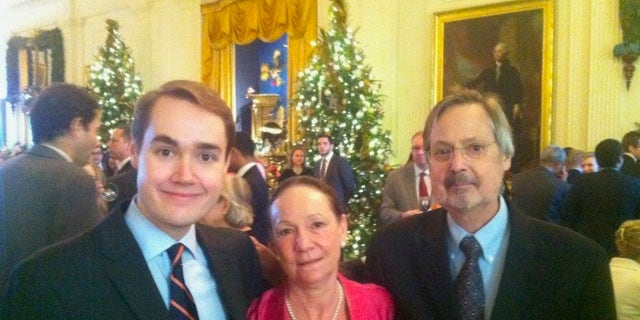 Bates, left, with his mother and his late father at the White House.