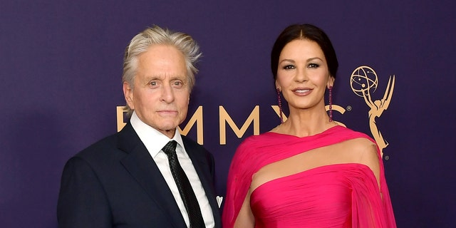 Michael Douglas (left) and Catherine Zeta-Jones met at the Deauville Film Festival. (Getty Images)