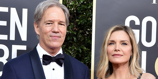 David E. Kelley and Michelle Pfeiffer are celebrating 27 years of marriage. (Photo by Axelle/Bauer-Griffin/FilmMagic)