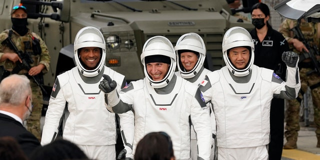 Astronauts, from left, Victor Glover, Michael Hopkins, Shannon Walker and Japan Aerospace Exploration Agency astronaut Soichi Noguchi. (AP Photo/John Raoux).
