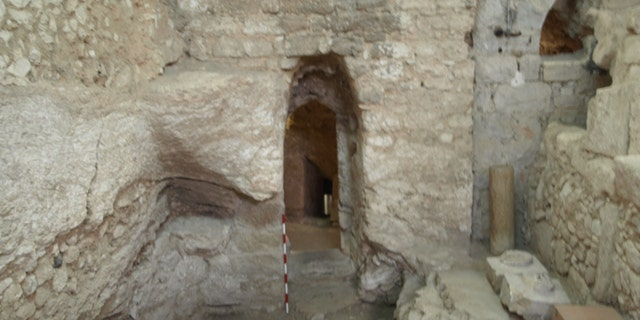 The first-century AD house showing the doorway and the only surviving section of the floor in front of it.
