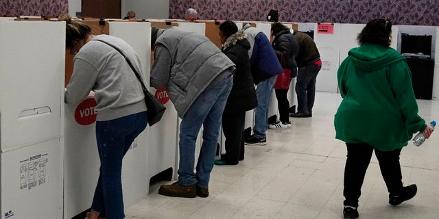Voters fill out their ballots once inside the polling place at the Oklahoma County Election Board, Thursday, Oct. 29, 2020, in Oklahoma City.