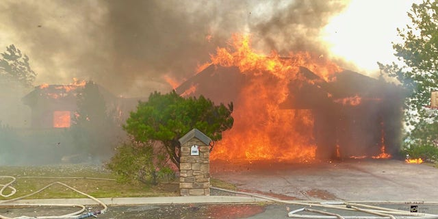 A wildfire destroyed several homes in a Reno neighborhood on Tuesday.